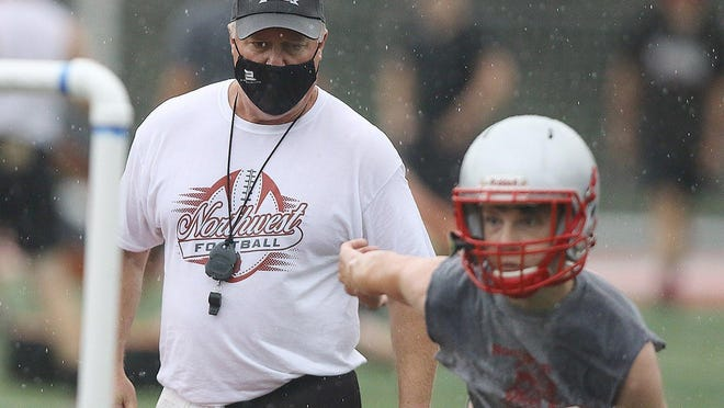 Northwest head coach John DeMarco watches a player during a drill on the first day of preseason practice on Saturday.