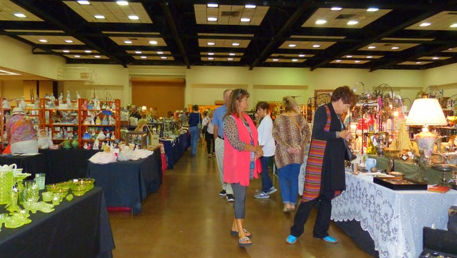 Rain outside didn't bother shoppers inside at the Lions annual antique show.