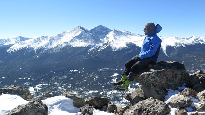 Fort Collins resident Jim Davidson sits atop South Twin Sisters Peak in Rocky Mountain National Park, with Longs Peak looming in the background March 6, 2015. In March, Davidson will make his second attempt to climb Mount Everest.