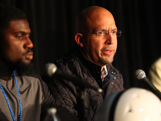 Penn State receiver Juwan Johnson (left) and head coach James Franklin answer questions after arriving in Phoenix on Saturday.
