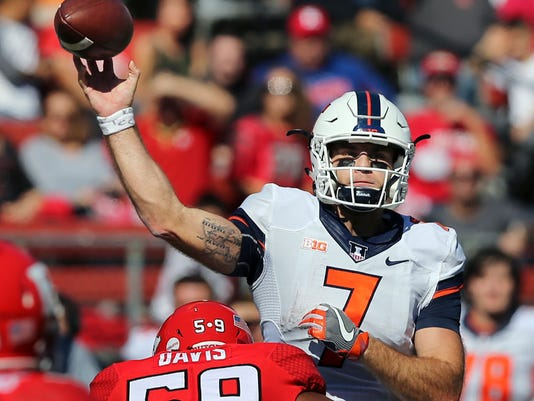 """FILE - In this Oct. 15, 2016, file photo, Illinois quarterback Chayce Crouch (7) throws a pass under pressure from Rutgers defensive lineman Darnell Davis (59) during the first half of an NCAA college football game in Piscataway, N.J. Crouch showed promise as a backup last season but injured his shoulder in his first start, against Rutgers, and missed the last six games. Crouch throws a nice ball, but he also gives the Illini a running threat they haven't had from that position since Nathan Scheelhaase in 2013. Crouch will go into the fall as the """"undisputed leader"""" of the Illini, coach Lovie Smith said. (AP Photo/Mel Evans, File)"""