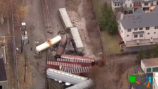 In this image taken from video and provided by WABC, a group of freight cars tangle up along the tracks after derailing in Union, N.J., Friday, Dec. 8, 2017.