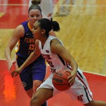 Keisha Gregory brings the ball into the paint during the first half of the game against TTU on Jan. 9.