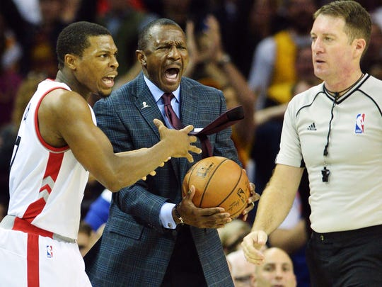 Toronto Raptors guard Kyle Lowry, left,  and head coach Dwane Casey argue a call as official Brent Barnaky walks away during the second half against the Cleveland Cavaliers at Quicken Loans Arena. A technical was called on Lowry. The Cavs won 121-117.