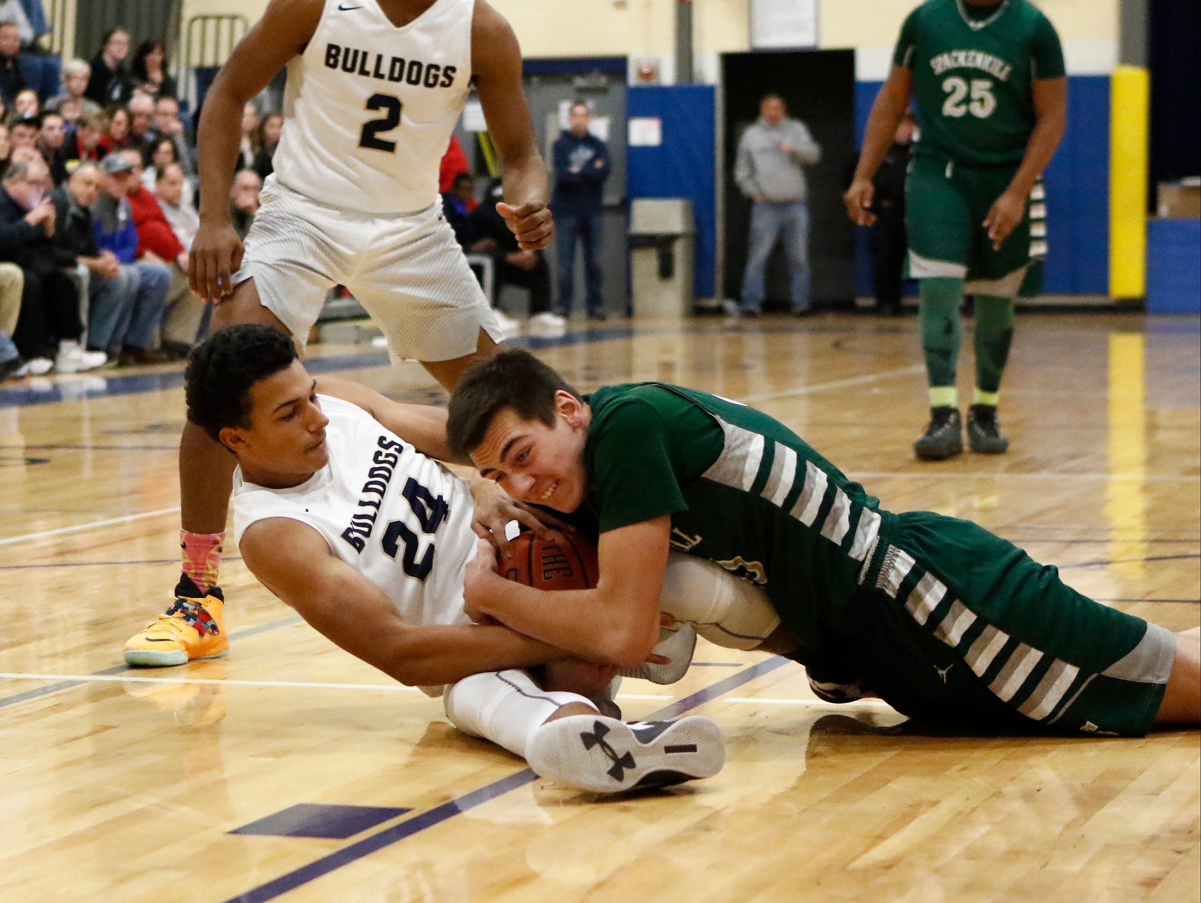 Beacon Dionte Komisar wrestles for a loose ball with Spackenkill's John Timm during the Duane Davis Memorial Tournament.