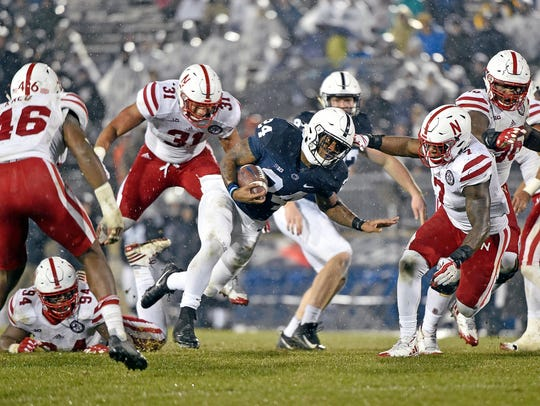 Penn State's DJ Brown carries the ball against Nebraska