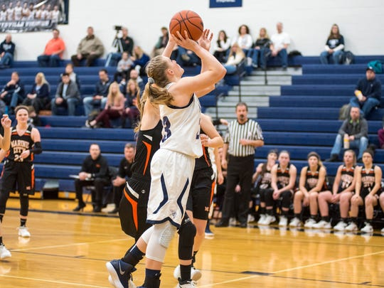 Marysville's Hannah Delor (23) shoots the ball during the MHSAA Class B District Championship against Marine City High School at Marysville High School Feb. 28. Delor's basket brought the score 4-6 Marine City.