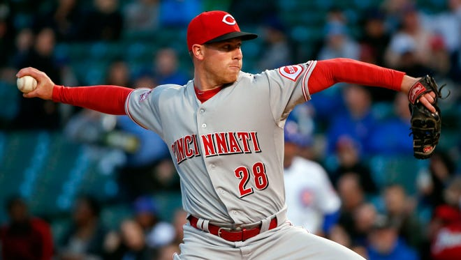 Reds starting pitcher Anthony DeSclafani delivers during the first inning Tuesday against the Chicago Cubs at Wrigley Field.