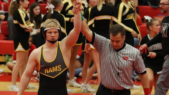 Southeast Polk Rams Gabe Christenson wins the 195 pound