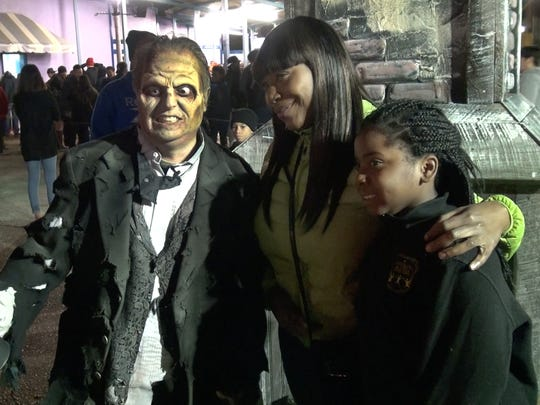 Jerry Carino gets his photo taken with park visitors as he works as a Zombie at Six Flag Great Adventure's Fright Fest in Jackson Township on October 17, 2015.