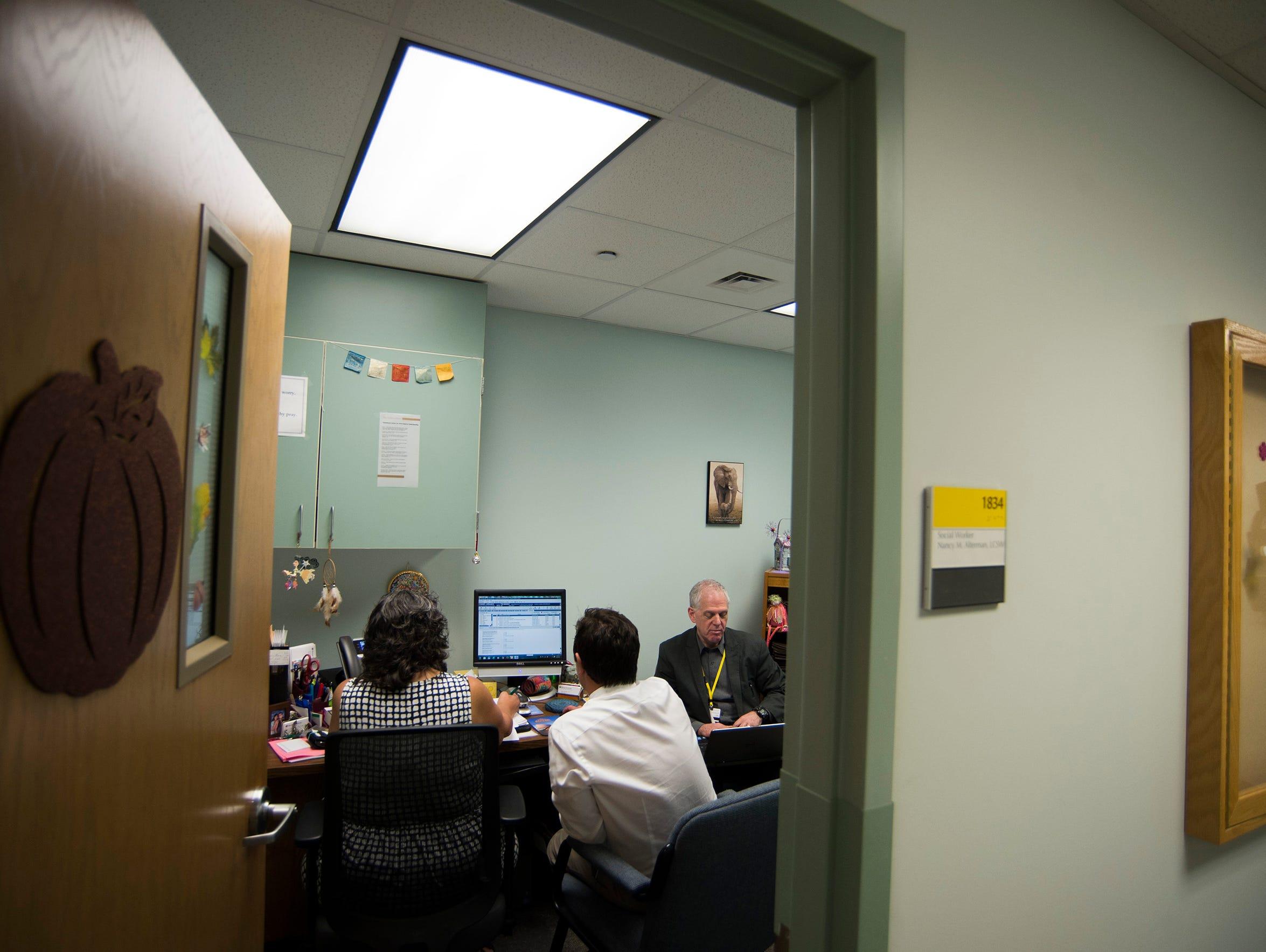 Geriatric social worker Nancy Alterman, from left,