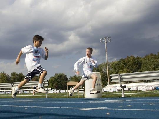 Two boys charge to the finish at one of the 2K races in the 2007 Great Race.