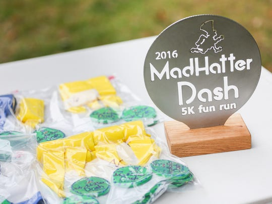 Medals and a trophy at the Mad Hatter Dash 5k fun run on Saturday, Sept. 24, 2016, at Wallace Marine Park. The medals were hand-painted by the children at the Salem Dream Center and the trophy was custom made by a local artist.