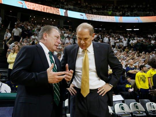 Michigan State coach Tom Izzo, left, talks with Michigan coach John Beilein.