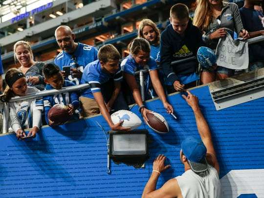 Lions quarterback Matthew Stafford signs autographs for fans during Family Day at Ford Field, Saturday, Aug. 5, 2017 in Detroit.