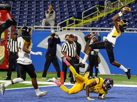 Detroit King's Ahmad Gardner intercepts the ball before the end of the first half against East English Village during the Detroit Public School League championship game at Ford Field, Friday, October 20, 2017.