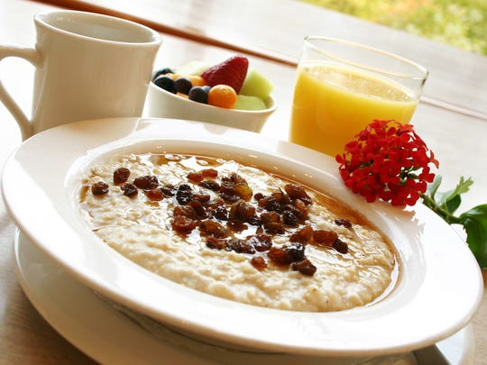 Freshly prepared oatmeal topped with raisins.