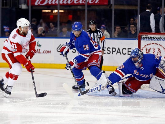 Rangers goalie Henrik Lundqvist (30) makes a save in
