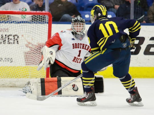 Hartland's Jake Behnke is stopped on a scoring chance in last season's state hockey semifinals by Birmingham Brother Rice goalie Ryan Hoffmann. The rematch will take place at 6:30 p.m. Saturday at Eddie Edgar Arena in Livonia.