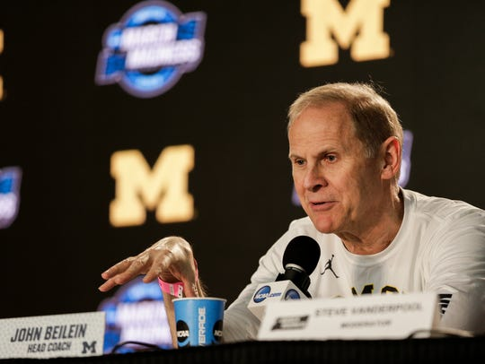 Michigan coach John Beilein answers a question during