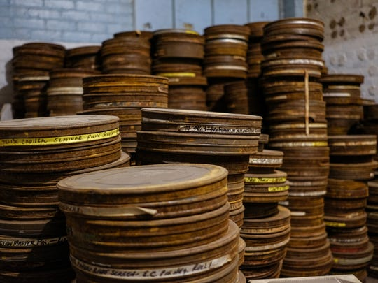 Stacks of film canisters holding reels of films shot