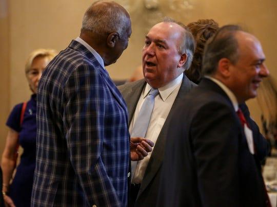 John Engler, Michigan State Interim President, talks with MSU Board Trustee Joel Ferguson at the Detroit Free Press Breakfast Club series hosted by columnist Carol Cain at the Townsend Hotel in Birmingham on Thursday, May 10, 2018.