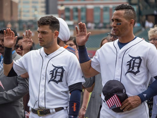Detroit Tigers' Jose Iglesias and Leonys Martin raise
