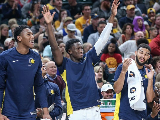 Players on the Pacers bench cheer during a 2017 game. Pacers GM Chad Buchanan has had photographs taken of the bench during games and displayed them in players' lockers. The photographs reinforce the importance of being happy for one another.