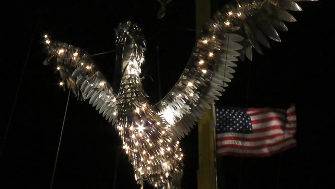 The Pelican is lit and waits to be lowered to bring in the new year Wednesday night during the downtown Pensacola New Year's Eve festivities.