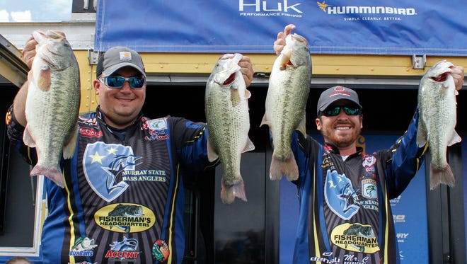 Murray State anglers Chandler Christian, left, and Lance Freeman show off their catches at a tournament.