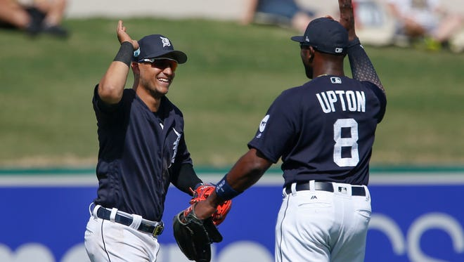 Tigers leftfielder Justin Upton (8) and shortstop Jose Iglesias (1) congratulate each other after they combined on a tipped ball catch during the fourth inning of the Tigers' 10-7 exhibition win Monday in Lakeland, Fla.
