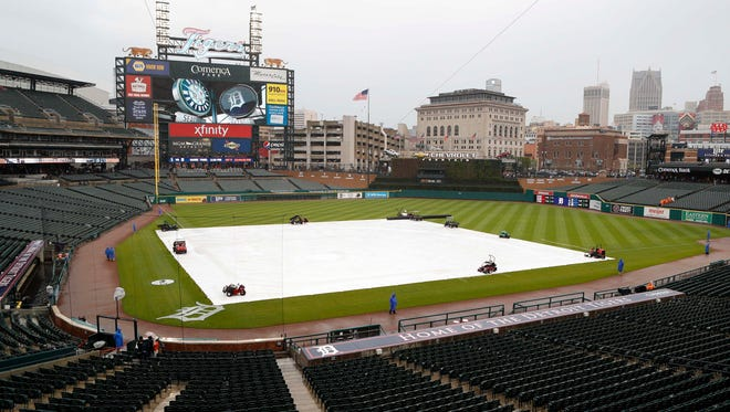 The infield is covered during a rain delay before the game between the Detroit Tigers and the Seattle Mariners Thursday at Comerica Park.