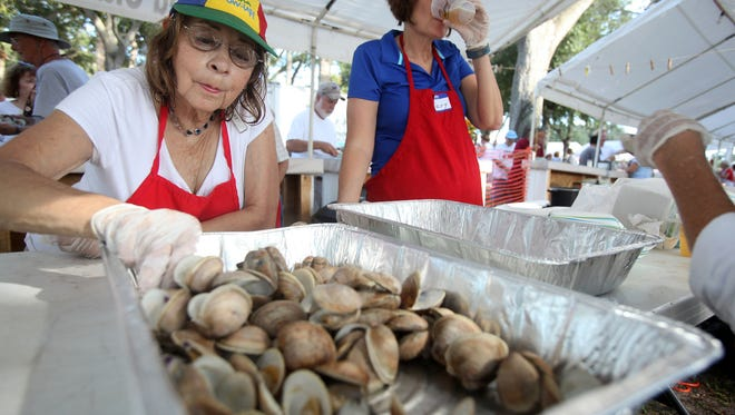 """Gina Belli, of Roseland, won the Sebastian Clambake slogan contest for the secondtime with """"America Runs on Clams,"""" which will be the central theme on this year's clambake T-shirts designed by local artist Lisanne Robinson. The festival is Friday through Sunday."""