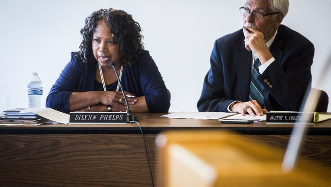 Assistant Superintendent DiLynn Phelps and chief financial officer Robert Coddington address the school board during a meeting at the Muncie Area Career Center Friday afternoon.