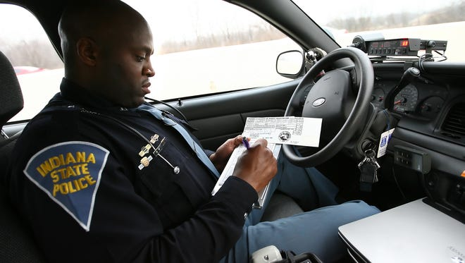 Indiana State Trooper Cedric Merritt issues a speeding ticket to a motorist who was traveling on I-465 North on Indianapolis' east side going 76 mph in a 55 mph zone.