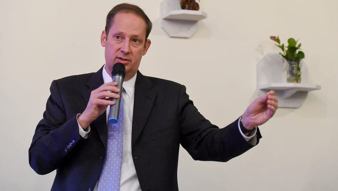 Florida State Senate President Joe Negron discusses policies and other issues related to Lake Okeechobee discharges and the Indian River Lagoon Thursday, Jan. 4, 2018, with local river advocates and concerned citizens during TCPalm's pop-up community conversation at Ground Floor Farm in Stuart.