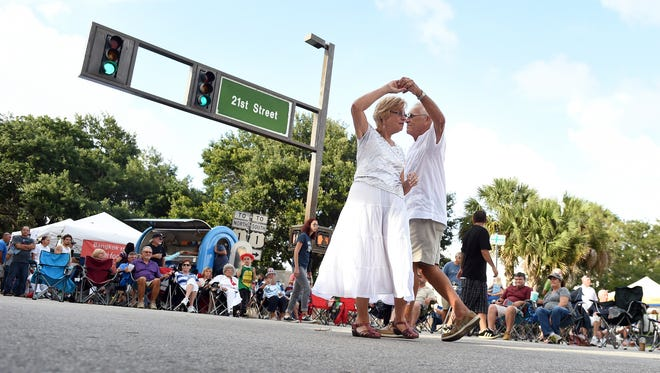 "Lois and George McAllan, of Vero Beach, dance May 27, 2016, to live music by ""The Jacks"" during the Downtown Friday event presented by Main Street Vero Beach along 14th Avenue and 21st Street in downtown Vero Beach. On Tuesday, Coastal Living named Vero Beach as a finalist for ""Happiest Seaside Town."""