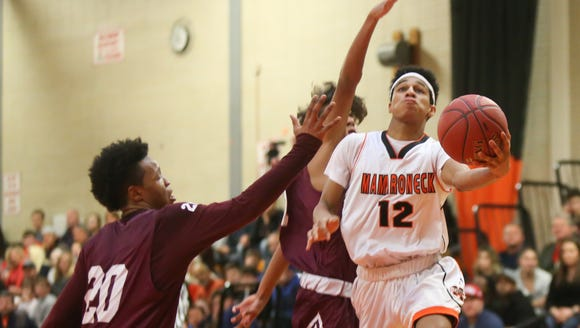 Mamaroneck's Isiah Thomas (12) puts up a shot during