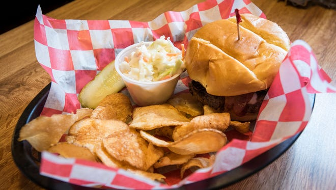 A variation on the Smokin' Burger, a spicy burger offered at Kelly Joy's Smokehouse. After moving out of the Active Lounge in Port Huron, the restaurant has opened a new location at 7116 Lakeshore Road, Lakeport.