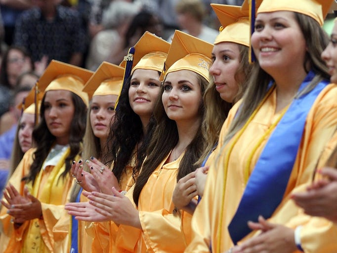 Spotswood High School graduates applaud at the beginning of the school's commencement, Monday, June 23, 2014, in Spotswood, NJ.  Photo by Jason Towlen