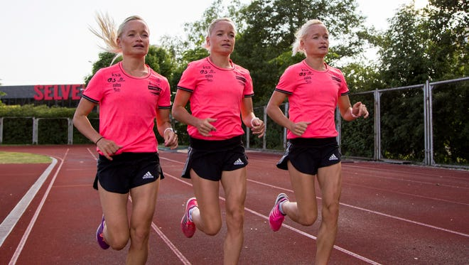 Estonian triplets Lily Luik, Liina Luik and Leila Luik attend a training session after an interview with The Associated Press.