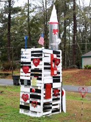"The prototype ""Intercontinental Ballistic Love Missile"" on West Indianhead Drive, pictured Monday, Feb 12, 2017. In lieu of a working ICBLM, an info sheet accompanying the display suggests a number of ""love action ideas"" including smile often, befriend neighbors and vote."