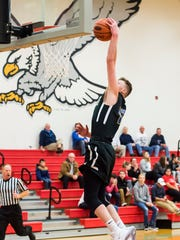 Kennard-Dale's Adam Freese slams down a dunk during play against Bermudian Springs on Dec. 8, 2017. The Rams defeated the Eagles 62-35.