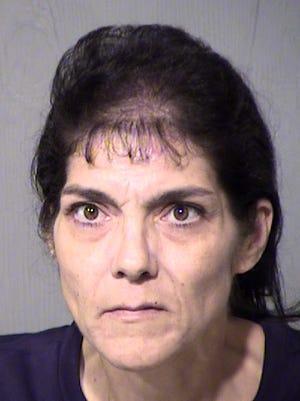 Barbara Christine McLaughlin was arrested on suspicion of aggravated assault and criminal damage.