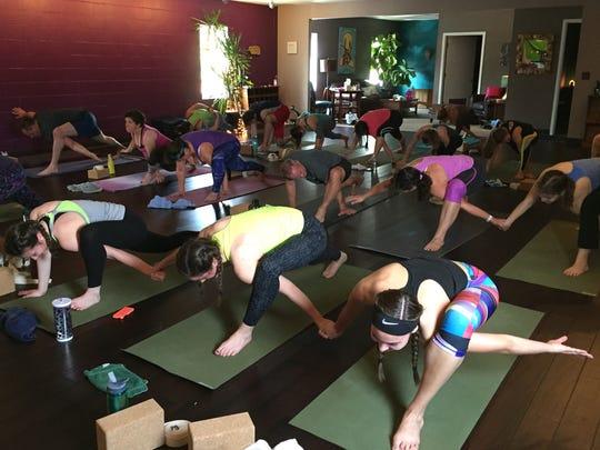 Regular students at Fearless Yoga in Wausau join Mosinee
