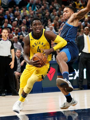 Indiana Pacers guard Victor Oladipo (4) drives on Oklahoma City Thunder forward Josh Huestis (34) in the first half of their game at Bankers Life Fieldhouse Wednesday, Dec 13, 2017.