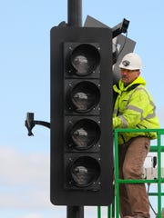 Scott Buntin, of Bodart Electric, installs traffic lights as part of the Monroe Avenue reconstruction project in Green Bay.
