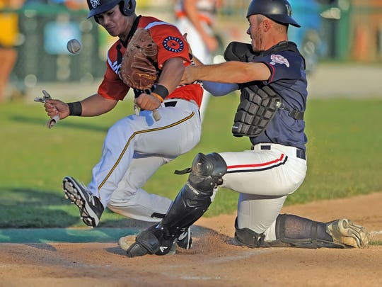 Aviator infielder Joe Murray strips Chillicothe catcher Jessie Forestell of the ball and his mitt to score as the Aviators host the Paints Friday night at Loeb Stadium.