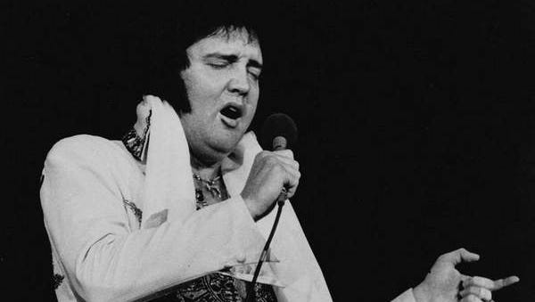 Elvis Presley is shown performing in May 1977, just months before his death.