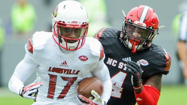 Oct 3, 2015; Raleigh, NC, USA; North Carolina State Wolfpack linebacker Jerod Fernandez (4) chases Louisville Cardinals wide receiver James Quick (17) during the second quarter against the Louisville Cardinals at Carter Finley Stadium. Mandatory Credit: Evan Pike-USA TODAY Sports